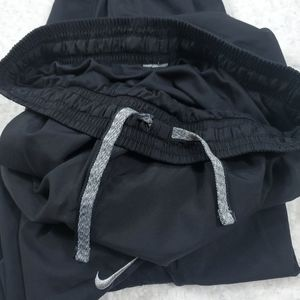 Nike Dri Fit Mesh Lined Ankle Zip Windbreaker Pant